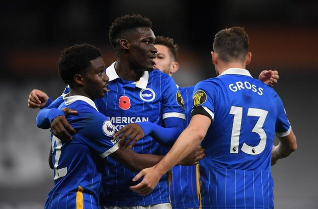 Tariq Lamptey of Brighton and Hove Albion celebrates with teammates Yves Bissouma and Pascal Gross. (Photo by Mike Hewitt/Getty Images)