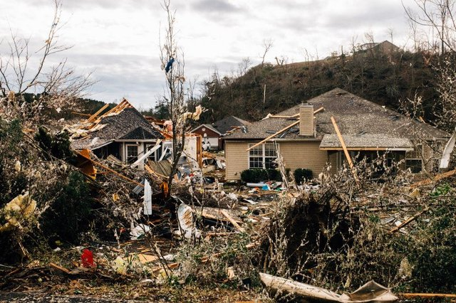Fallen trees damage a property in the wake of a tornado in Fultondale, Alabama.