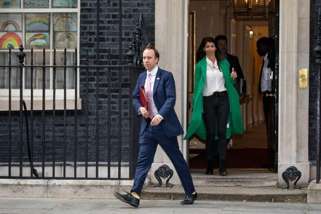 Matt Hancock leaves Downing Street in May, with Gina Coladangelo in the green coat (Photo: Getty Images)