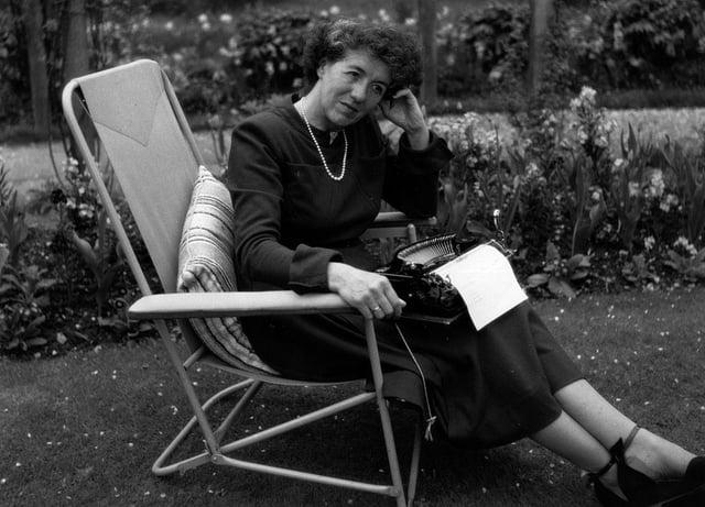 Enid Blyton sitting in her garden in Beaconsfield, Buckinghamshire (Photo: George Konig/Getty Images)