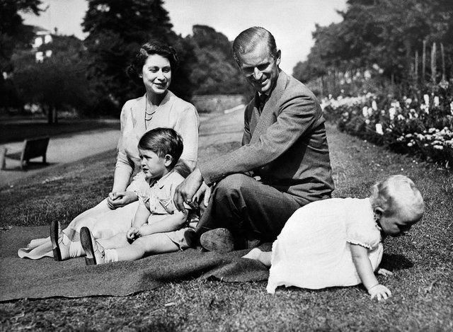 Queen Elizabeth and the Duke of Edinburgh with their two children Prince Charles and Princess Anne in 1951. (Photo: OFF/AFP/ Getty Images)