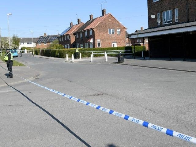 A large police cordon remains in place around Stanks Parade in Leeds as forensics officers search the area (Photo: Gary Longbottom).