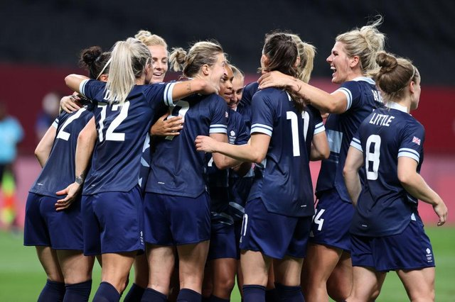 Ellen White celebrates with Millie Bright  and teammates after scoring their side's second goal.