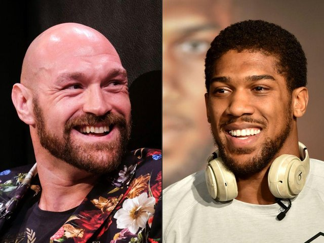 Anthony Joshua labels Tyson Fury a 'fraud'; Fury suggests 'bare-knuckle till 1 man quits' for 40m (Photo by RINGO CHIU,FAYEZ NURELDINE/AFP via Getty Images)
