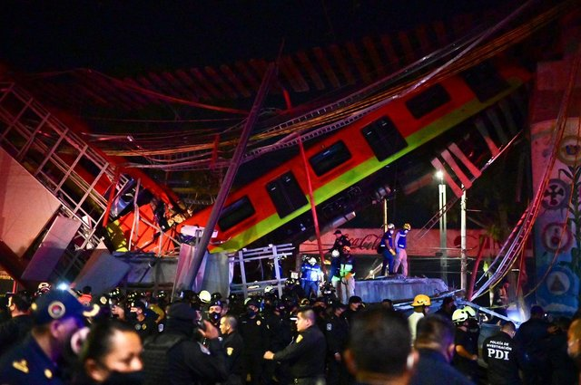 Rescue workers gather at the site of a metro train accident after an overpass partially collapsed in Mexico City (Photo by Pedro PARDO / AFP) (Photo by PEDRO PARDO/AFP via Getty Images)
