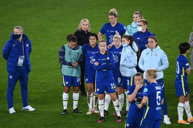 Emma Hayes and Chelsea's team looks on after the end of the UEFA Women's Champions League final.