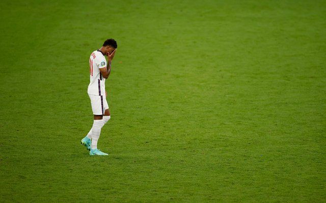 Marcus Rashford reacts after missing England's third penalty in the penalty shoot out during the UEFA Euro 2020 Championship Final against Italy (Photo by John Sibley - Pool/Getty Images)