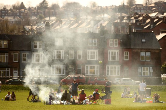 People enjoy the sunshine in Endcliffe Park in Sheffield as lockdown rules allow 30 people to meet outside (Getty).