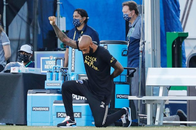 Thierry Henry takes a knee in support of the Black Lives Matter movement prior to a game for Montreal Impact. Henry has since announced he has deactivated his social media accounts.
