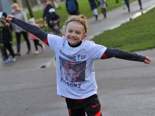 Jordan Banks, 9, died after being struck by lightning on May 11. Here he is pictured running a marathon in Stanley Park to raise money for a mental health charity.