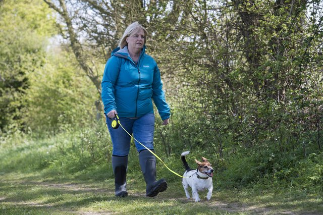 An actress (pictured) plays the role of PCSO Julia James walking her Jack Russell dog Toby - as they reconstruct the route taken by Julia and Toby in the fields behind her home in the hamlet of Snowdown, near Aylesham, Ken (PA).