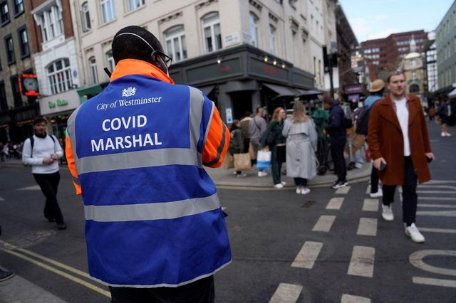 A 'Covid Marshall' from Westminster City Council ensures people are following the Covid restricitions as pubs and hospitality venues reopen across England (Picture: Getty Images)