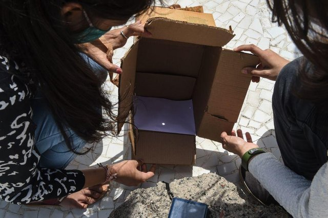 A pinhole camera is a safe and easy way to view an eclipse (Photo: SAM PANTHAKY/AFP via Getty Images)