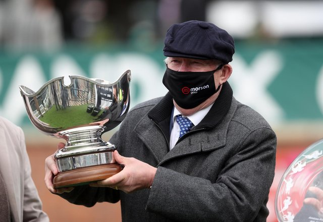 Sir Alex Ferguson collects the trophy after winning the Betway Bowl Chase to complete a hat-trick of wins in the first three races on Liverpool NHS Day of the 2021 Randox Health Grand National Festival at Aintree Racecourse, Liverpool.