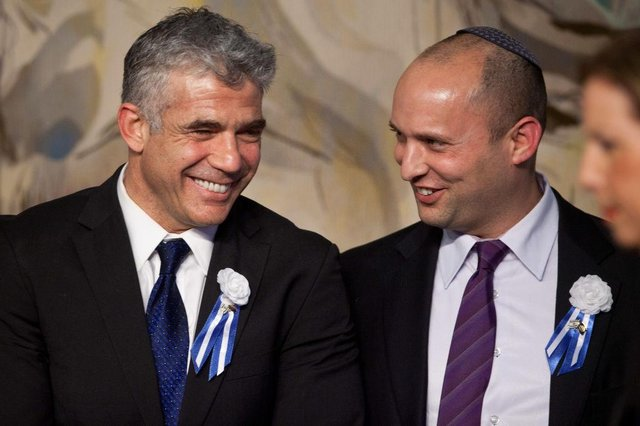 Yair Lapid (L), leader of the Yesh Atid party and Naftali Bennett have formed a coalition (Getty Images)