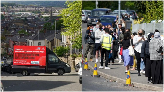 A electronic Covid-19 warning billboard drives around the streets in Blackburn, while people queue for vaccinations at the ESSA academy in Bolton (Getty Images)