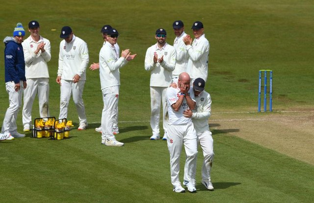 Durham bowler Chris Rushworth is congratulated by captain Scott Borthwick (r) and team-mates after taking the wicket of Worcestershire batsman Jack Haynes for his 528th first class wicket for Durham, beating the previous record set by Graham Onions.