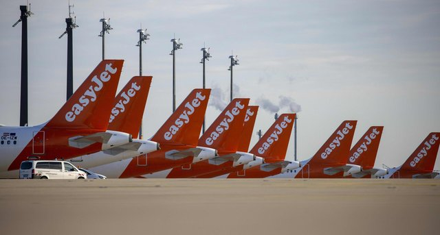 """Easyjet planes are seen parked at the """"Berlin Brandenburg Airport Willy Brandt"""" in Schoenefeld, southeast of Berlin (Photo by ODD ANDERSEN/AFP via Getty Images)"""