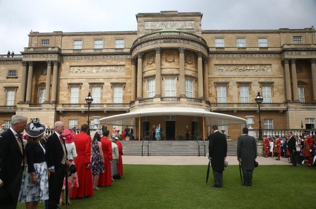 Guests waiting for Queen Elizabeth II as while attending a Garden Party at Buckingham Palace in 2018 (Photo: Yui Mok - WPA Pool/Getty Images)