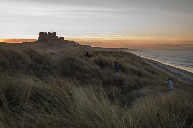The sun sets behind Bamburgh Castle (Photo: Dan Kitwood/Getty Images)