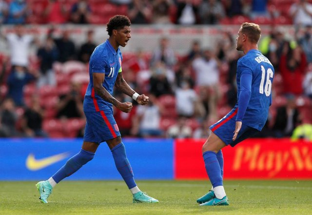 Marcus Rashford of England celebrates after scoring from the penalty spot.