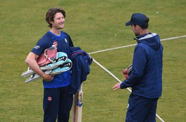 Durham batsman Cameron Bancroft (l) chats with coach James Franklin after a net session.