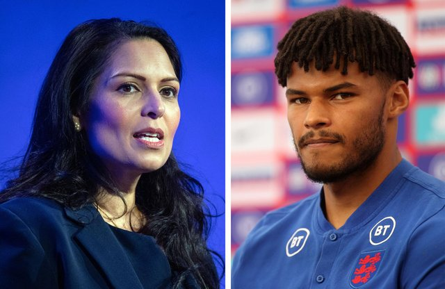 England footballer Tyrone Mings (pictured right) accused Priti Patel (pictured left) of 'stoking the fire' of racist abuse after previously saying taking the knee was 'gesture politics'. (Pic: PA)