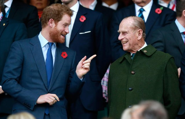 Prince Harry and Prince Phillip enjoy the atmosphere during the 2015 Rugby World Cup Final match between New Zealand and Australia at Twickenham Stadium (Photo by Phil Walter/Getty Images)