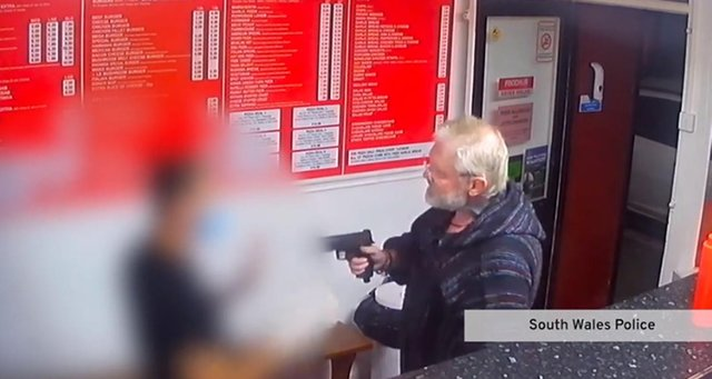 Footage of the man pulling the imitation firearm in the kebab shop (Photo: police handout)