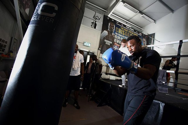 Derek Chisora trains on a punchbag. The fighter has a new trainer in his camp.
