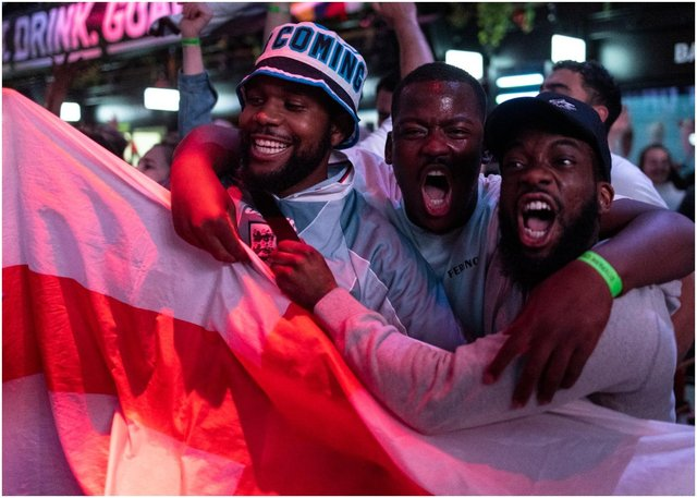 England fans cheer at BOXPARK Croydon as they watch a live broadcast of the semi-final match between England and Denmark  (Getty Images)