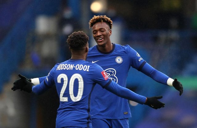Tammy Abraham of Chelsea celebrates with team mate Callum Hudson-Odoi. (Photo by Catherine Ivill/Getty Images)