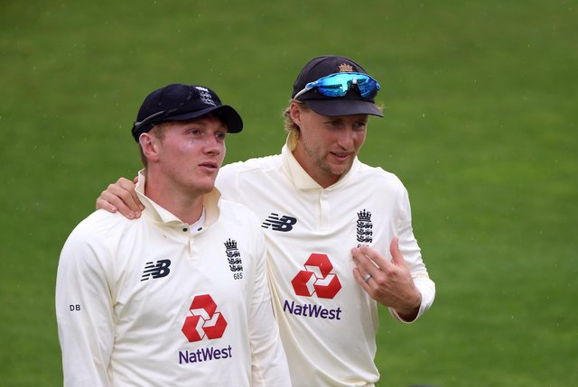 England captain Joe Root with spinner Dom Bess (left).
