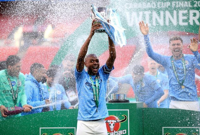 Manchester City's Fernandinho lifts the trophy as he celebrates winning the Carabao Cup Final at Wembley Stadium, London. (Photo: Adam Davy/PA Wire)