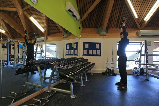 A man works out in a indoor gym at a reopened sports and fitness centre in Scunthorpe, as coronavirus restrictions are eased after England's third national lockdown on April 12.