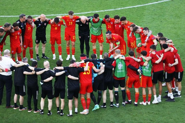 Gareth Bale of Wales speaks to the team as they form a huddle following the UEFA Euro 2020 Championship Group A match between Wales and Switzerland.