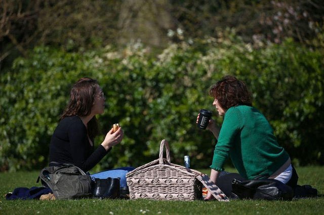 The warmer weather is set to coincide with the lifting of Covid restrictions around the UK (Photo: HOLLIE ADAMS/AFP via Getty Images)