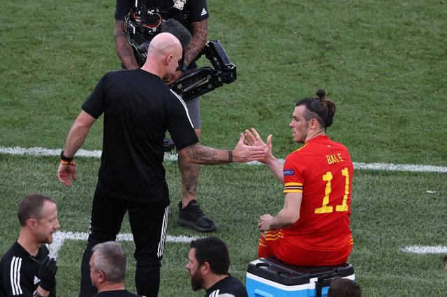 Wales' coach Robert Page celebrates with forward Gareth Baleafter the Italy game in which they secured qualification from Group A.