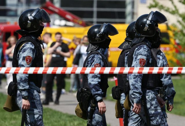 Russian National Guard officers outside school No175 where the attacks were carried out (Getty Images)
