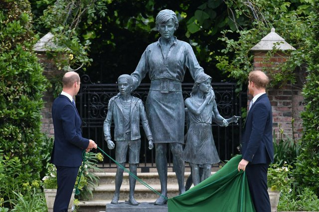 Britain's Prince William, Duke of Cambridge (L) and Britain's Prince Harry, Duke of Sussex unveil a statue of their mother, Princess Diana at The Sunken Garden in Kensington Palace, London on July 1, 2021, which would have been her 60th birthday. - Princes William and Harry set aside their differences on Thursday to unveil a new statue of their mother, Princess Diana, on what would have been her 60th birthday. (Photo by Dominic Lipinski / POOL / AFP) (Photo by DOMINIC LIPINSKI/POOL/AFP via Getty Images)