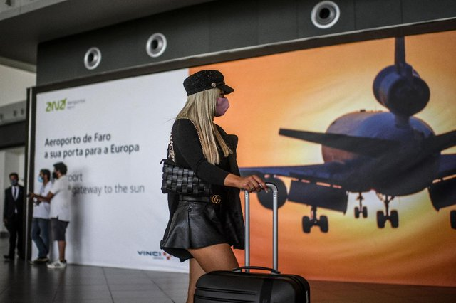 A passenger arrives at Faro airport in Algarve, south of Portugal when travel restrictions were lifted in May (Getty Images)