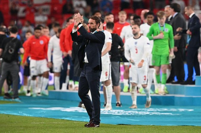England's coach Gareth Southgate applauds supporters after England lost to Italy in the UEFA EURO 2020 final football match between Italy and England at the Wembley Stadium in London on July 11, 2021. (Photo by Paul ELLIS / POOL / AFP) (Photo by PAUL ELLIS/POOL/AFP via Getty Images)