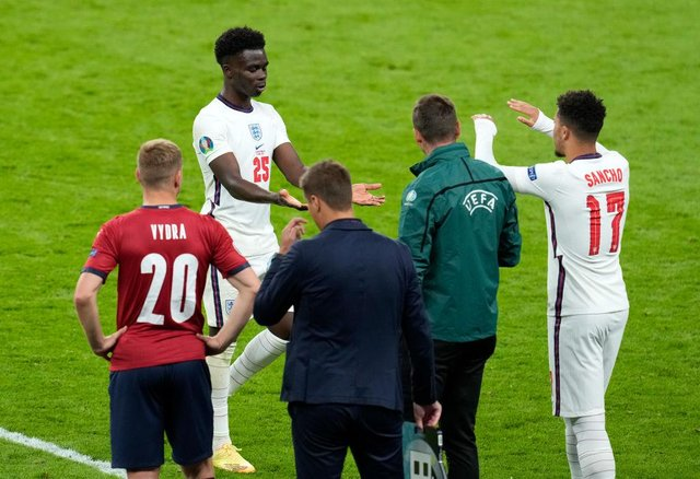 Jadon Sancho of England interacts with team mate Bukayo Saka after he replaced him as substitute against Czech Republic.