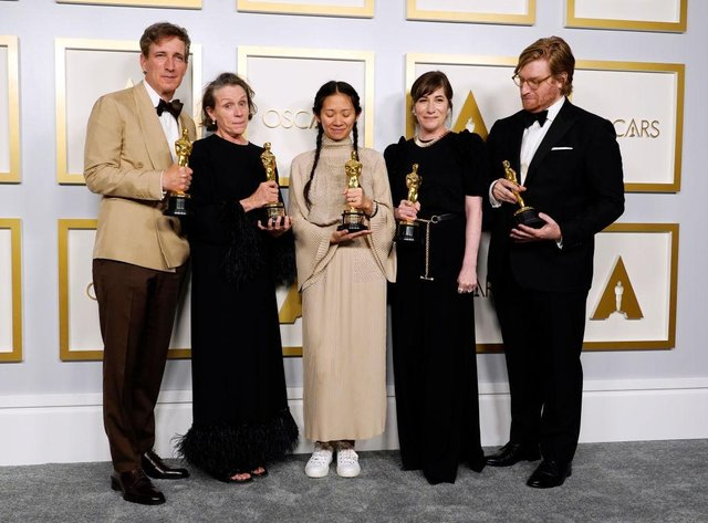 """(L-R) Peter Spears, Frances McDormand, Chloe Zhao, Mollye Asher, and Dan Janvey accepted their awards for Best Picture for """"Nomadland,""""  at the Oscars on Sunday, 25 April 2021 (Picture: Getty Images)"""