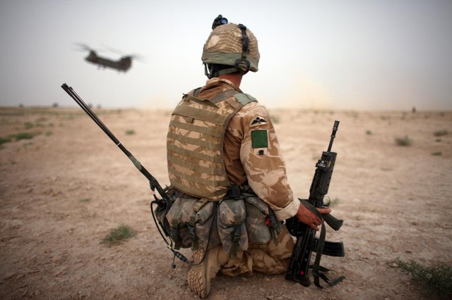 A British Army soldier from the 3rd Battalion The Parachute Regiment secures the helicopter landing strip (HLS) in 2008 during operation Southern Beast in Kandahar Province, Afghanistan (Photo by Marco Di Lauro/Getty Images)