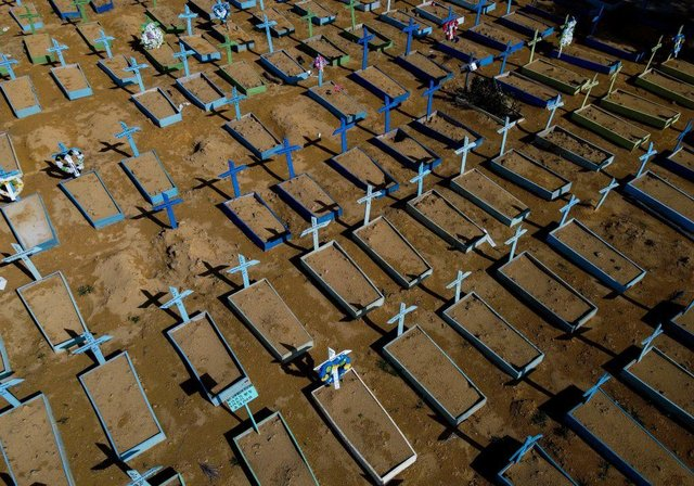 Aerial view of the graves of COVID-19 victims at the Nossa Senhora Aparecida cemetery in Manaus, Amazon state, Brazil, on April 15, 2021. Global death toll from Covid-19 passes 3 million people (Photo by MICHAEL DANTAS/AFP via Getty Images)
