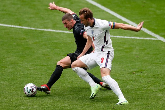 Germany's defender Robin Gosens (L) vies for the ball with England's forward Harry Kane during the UEFA EURO 2020 round of 16 football match between England and Germany at Wembley Stadium in London on June 29, 2021. (Photo by MATTHEW CHILDS / POOL / AFP) (Photo by MATTHEW CHILDS/POOL/AFP via Getty Images)