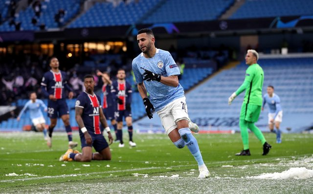 Manchester City's Riyad Mahrez celebrates scoring their side's first goal of the game against Paris Saint-Germain during the UEFA Champions League semi final second leg at the Etihad Stadium.