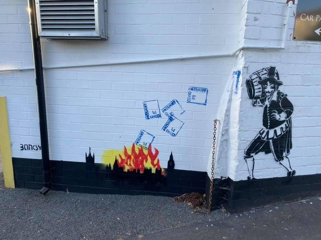 Guy Fawkes throwing Covid passports into the flames of a fire on the side of the Guy Fawkes Arms pub in the Harrogate district. (Picture by Charles Mackenzie)