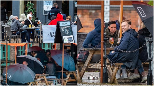 People braved the elements to drink outside in England during the bank holiday (SWNS)